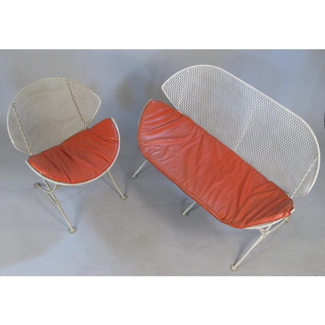 A vintage 1950s matching settee and lounge chair from the Orange Slice series by Salterini. These classic and iconic...