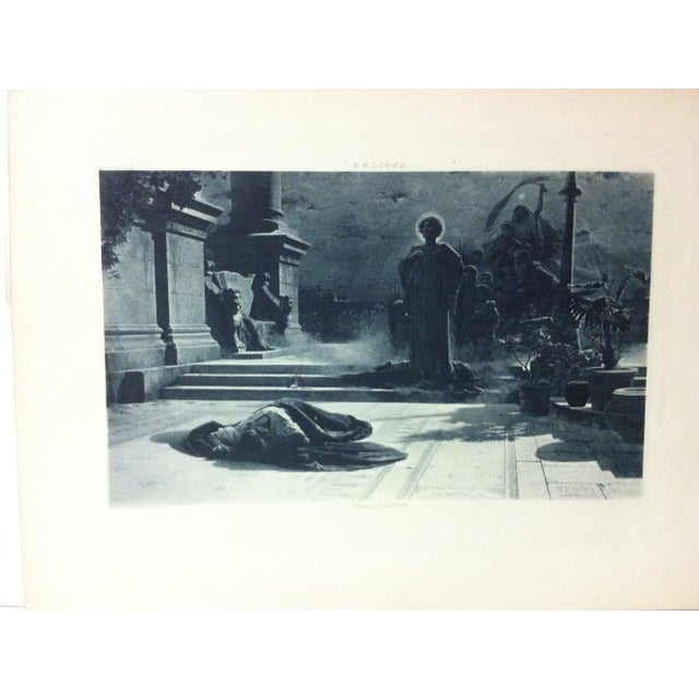 """This is an antique photogravure on paper that is titled """"The Victims of Galerius"""" by E.K. Liska. The photogravure dates..."""