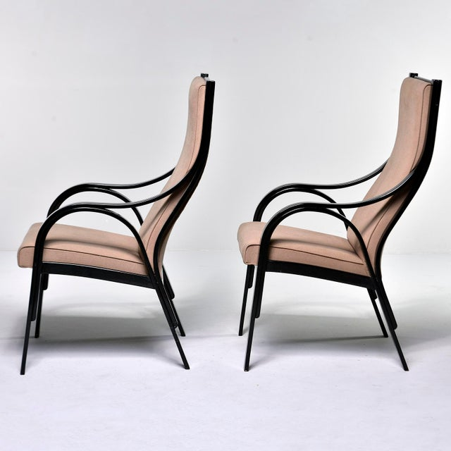 Pair circa 1960s Italian armchairs feature high seat backs, curved, bentwood arms and base. Newly upholstered in pale...