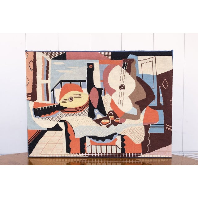 This cubist needlepoint art piece was hand made in the 1960s, and is a reproduction of Picasso's 'Mandolin and Guitar'. We...