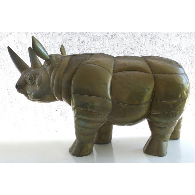 Offered for sale is a large brass rhino sculpture in brass by Sergio Bustamante for SerMel. In 1963, Sergio Bustamante and...