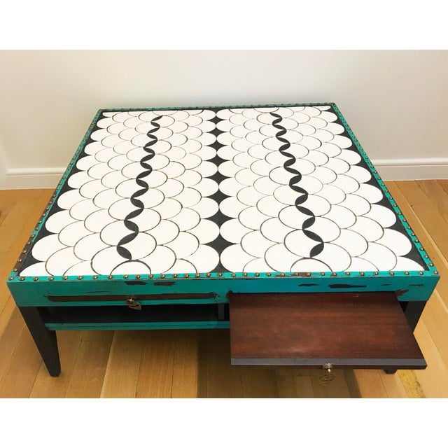 Solid wood great quality coffee table Refinished and distressed with turquoise chalk paint. Tiled with with flock tile and...