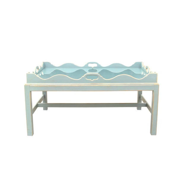 Lexington cocktail tray table lacquered in aqua with gold edging. The top houses a glass insert which sits inside the...