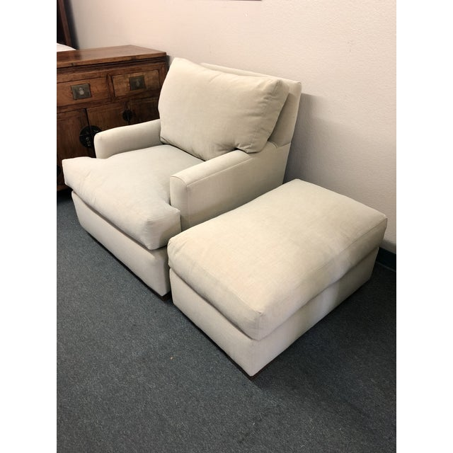 Design Plus Gallery presents a custom Armchair with Ottoman. Down filled back cushion and down wrapped seat cushion and...