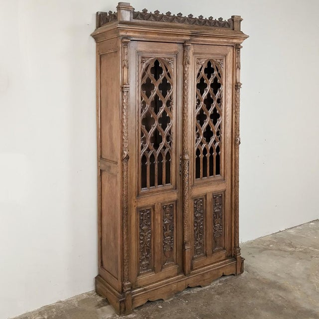 19th Century French Gothic Bookcase ~ Vitrine was meticulously hand-carved from solid oak in the timeless style that has...
