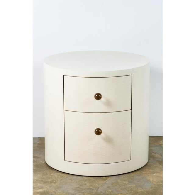 Paul Marra Italian-inspired 1970s style contemporary round nightstand or side table. Shown in bleached sycamore vaneer,...