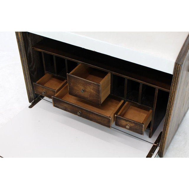 Tooled leather wrapped Campaign style transportable secretary desk with matching bachelor chest. Two part cabinet. All...