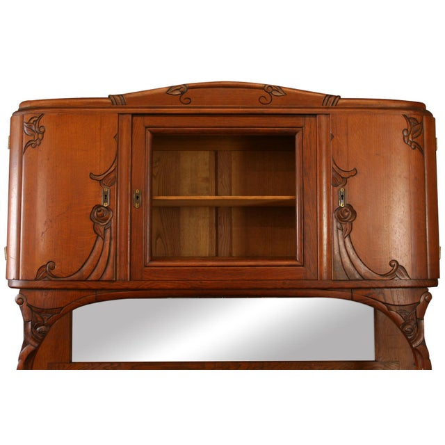 Offered is a gorgeous antique oak and mahogany buffet circa 1920s. The styling of this piece is gorgeous, it features a...