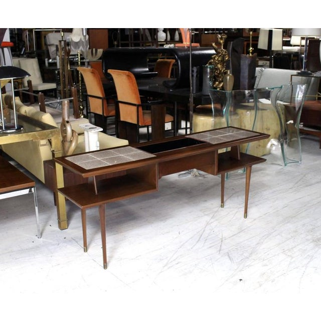 https://chairish-prod.freetls.fastly.net/image/product/sized/799d9e0e-a3a9-497f-9d72-6865aa2a88f0/two-tier-walnut-sofa-table-with-tile-top-and-planter-5436?aspect=fit&width=640&height=640