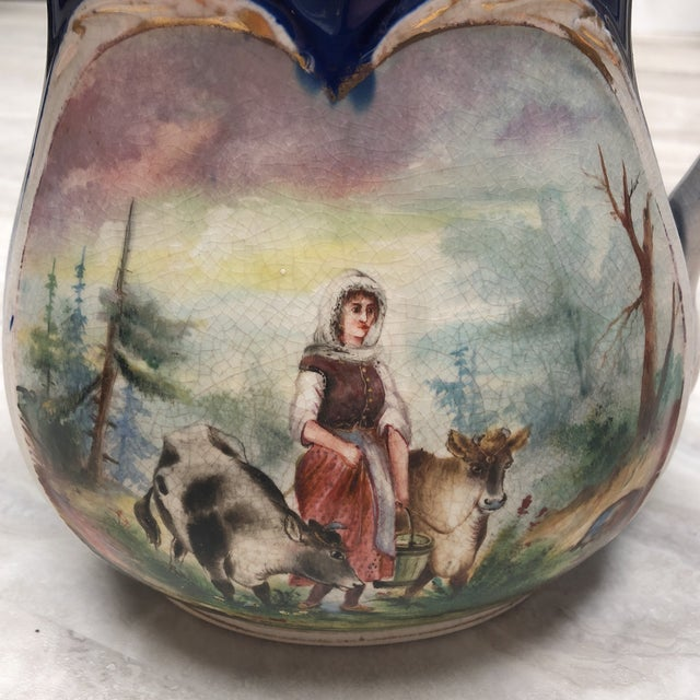 Antique English circa 1900 large Ironstone pitcher with two different scenes; milkmaid with cows and a black and white...