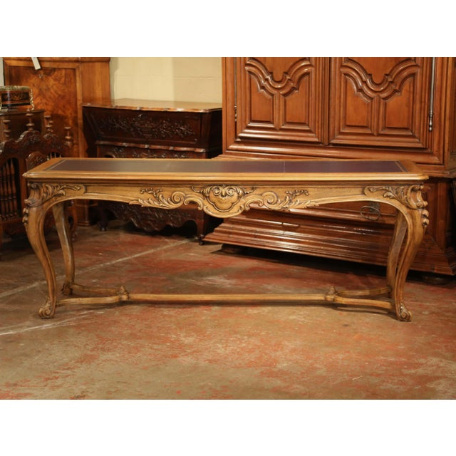 This long and elegant fruitwood table was crafted in Paris, France, circa 1880. The antique desk sits on four cabriole...