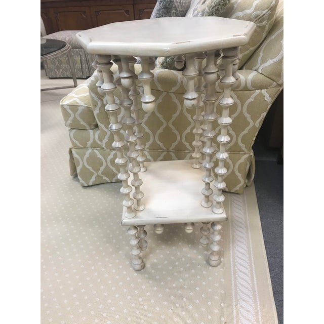 A wonderful two tier side table with spindle leg detailing and accents. Finished in a soft cream neutral tone with hints...