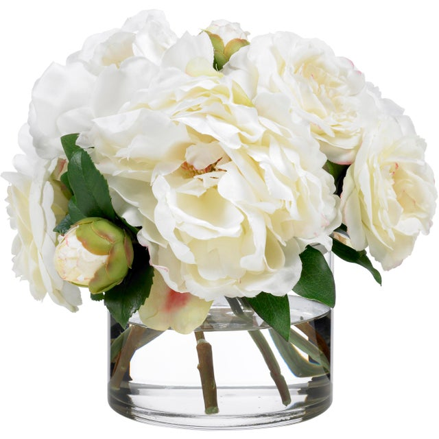 This arrangement of creamy white camellias and peonies brings together Coco Chanel's favorites flowers and captures her...