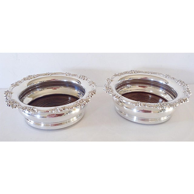 Elegant pair of matching silver wine coasters gives you the option of serving your guests both white and red, or having a...
