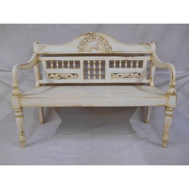 Hand carving and distressing give this garden style bench a great look. Features a setting sun center carving adorned with...
