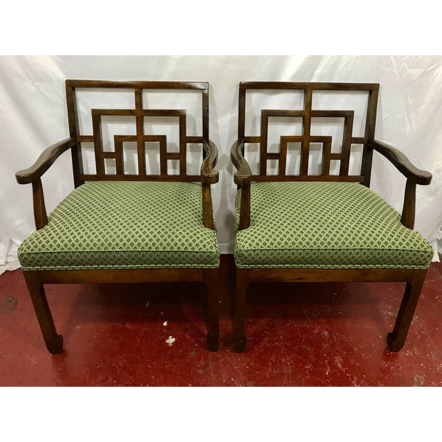 How cool are these? A pair of 1970s walnut side chairs with a very cool interpretation of a Chinese Chippendale back....