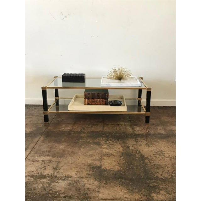Pierre Vandel black and brass 2 tier coffee table. Pierre Vandel was a French furniture company known for their luxury...