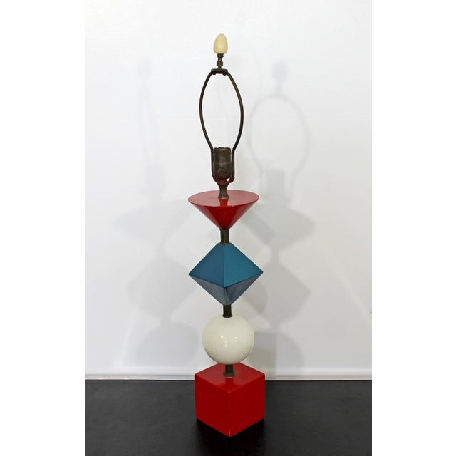 For your consideration is a stunning, multi-colored table lamp, made of stacked shapes and with its original finial, by...
