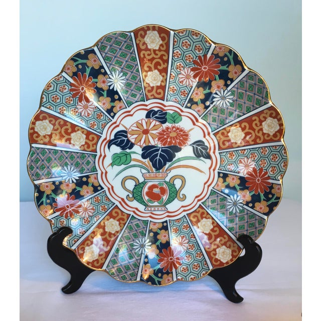 Three-piece beautifully handpainted Imari porcelain Japanese dish set. The set includes a platter/charger, pedestal...