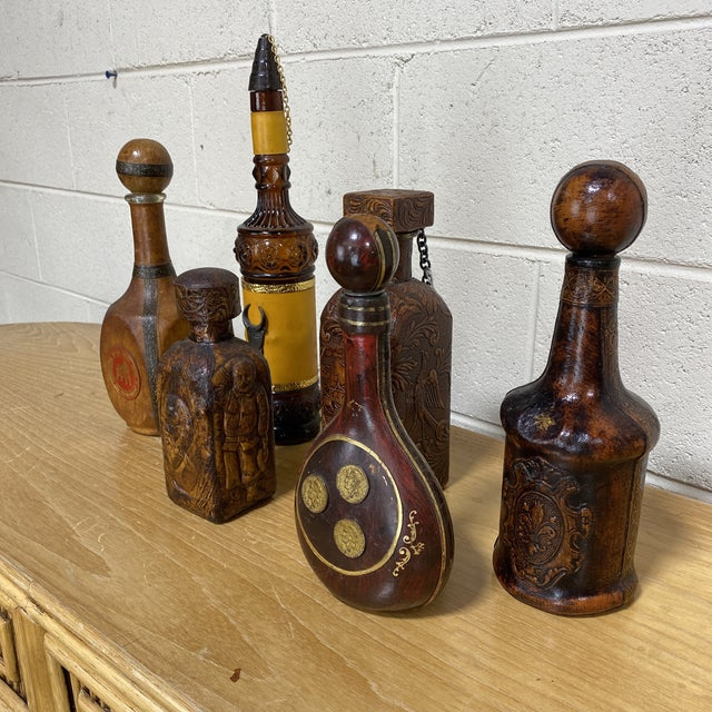 Selling this entire collection of unique Italian leather liquor bottles. Each one is unique and in great shape. They...