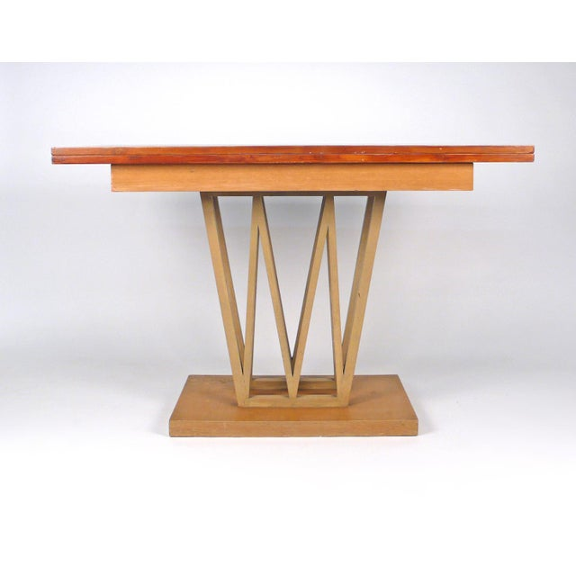 Very cool console table that could also be used as a dining table. Opens to 43.75 depth