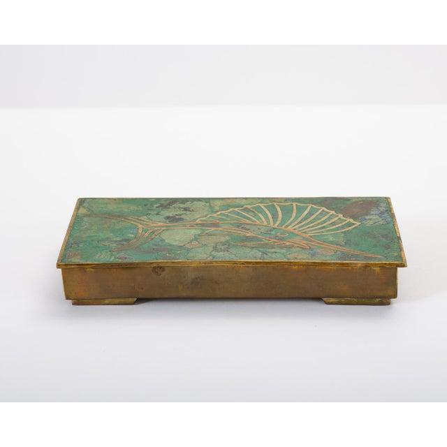 A modern interpretation of cloisonné technique after the designs of José Mendoza for Pepe Mendoza. The brass box has a...