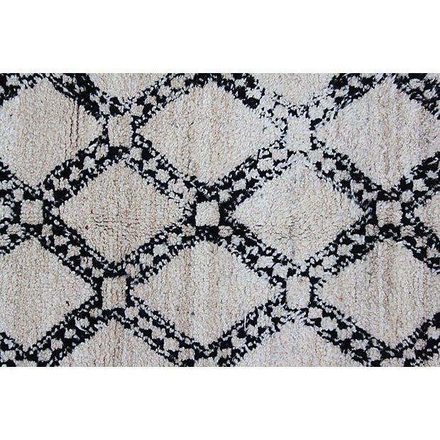 """This gorgeous 6'1"""" x 3'8"""" rug was hand-loomed in soft organic wool in the 1970s. With simple harlequin patterns and tribal..."""
