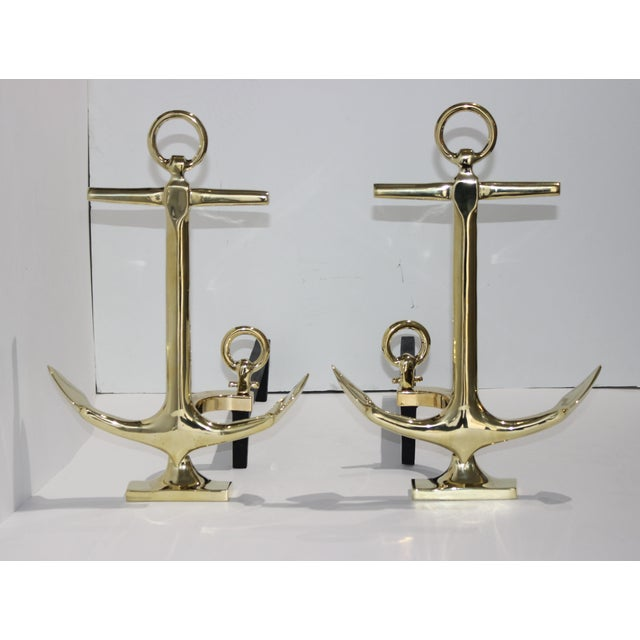 This stylish set of polished brass anchor-form andirons date to the 1960s and have been professionally polished and...