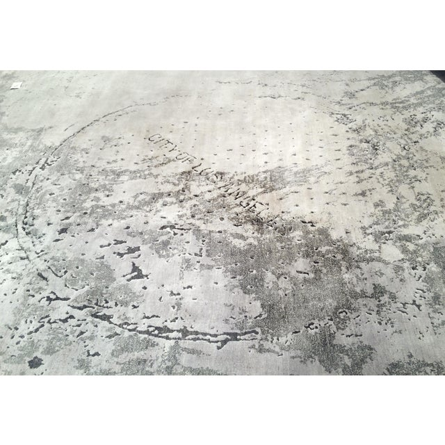 """Called """"City of Los Angeles,"""" this carpet is finely woven with silk and oxidized wool. Based on rubbings of manhole covers..."""