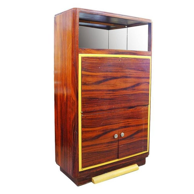 Rare late Art Deco vitrine cabinet with a medium stained Macassar veneer and mirror backed bar on top. Underneath is a...