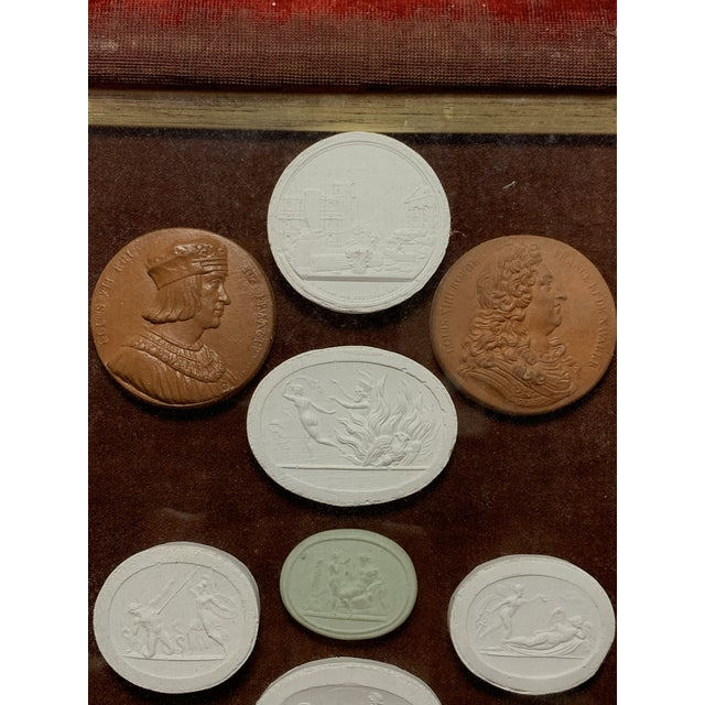 Grand Tour Early 19th Century Arrangement of Grand Tour Plaster Cameos in Velvet Frame For Sale - Image 3 of 10