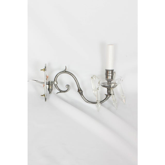 A pair of antique silver and crystal sconces. Delicate sconces, with 4.5″ x 2.5″ backplates. Completely restored and ready...