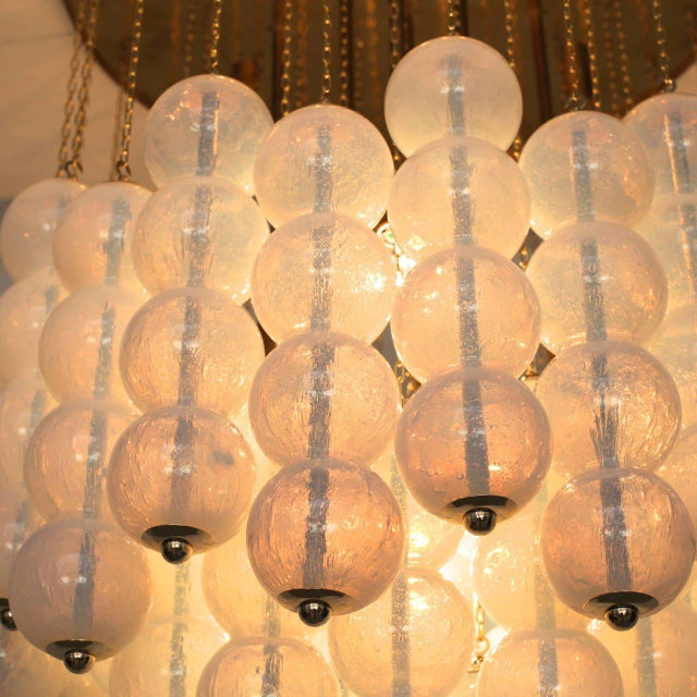 Very huge, iconic Murano opaline glass and brass chandelier by Zero Quattro. The chandelier is manufactures in high...
