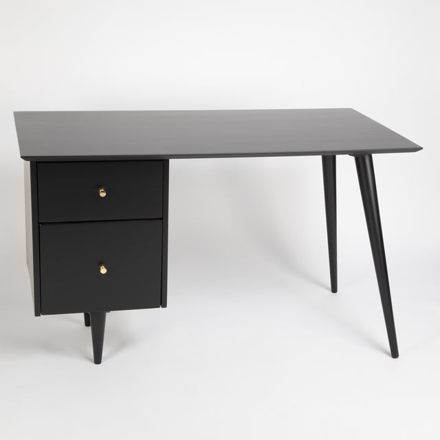 Elegant desk by American design icon Paul McCobb, produced for his Planner Group collection for Winchendon Furniture,...