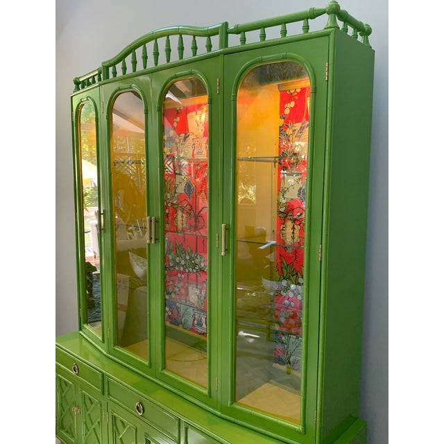 Freshly lacquered Asian chinoiserie style two piece china cabinet makes a real statement with it's stunning high gloss...