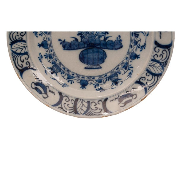 A late 17th early 18th Century Dutch blue and white Delft charger