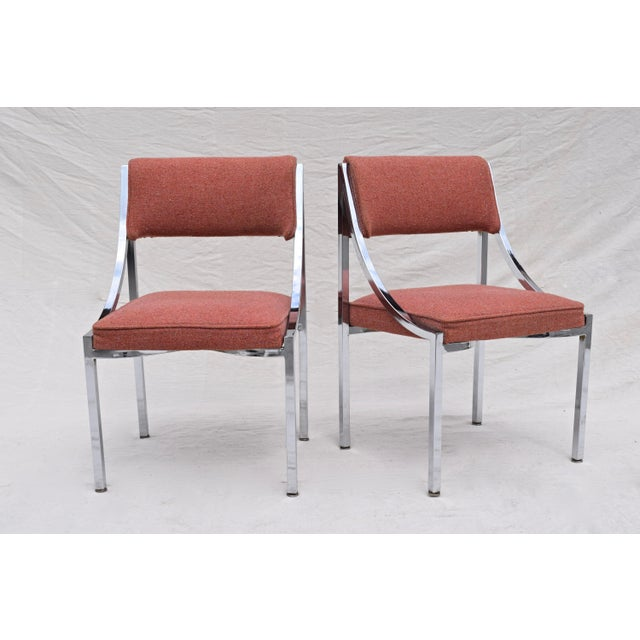 A set of five swag-arm chrome dining chairs by Wolfgang Hoffman for Howell Interlake Company. Noteworthy, excellent...