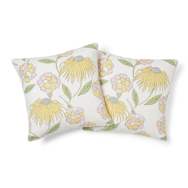 """This 18"""" x 18"""" pillow features Bouquet Toss, a linen and cotton blended fabric, in Pink Lemonade. Inspired by a vintage..."""