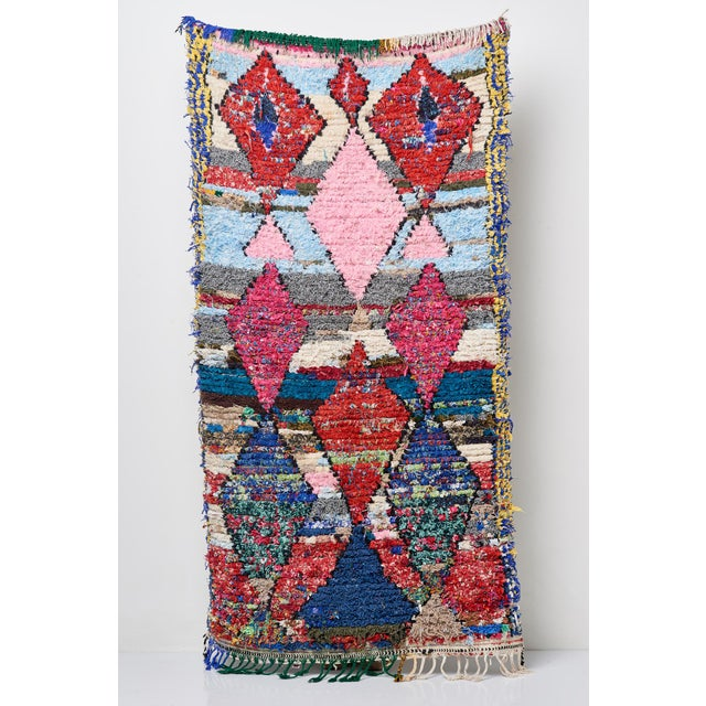 Fantastic accent rich multi colored Moroccan Boucherouette Rug. These look great layered or alone. This one features a...