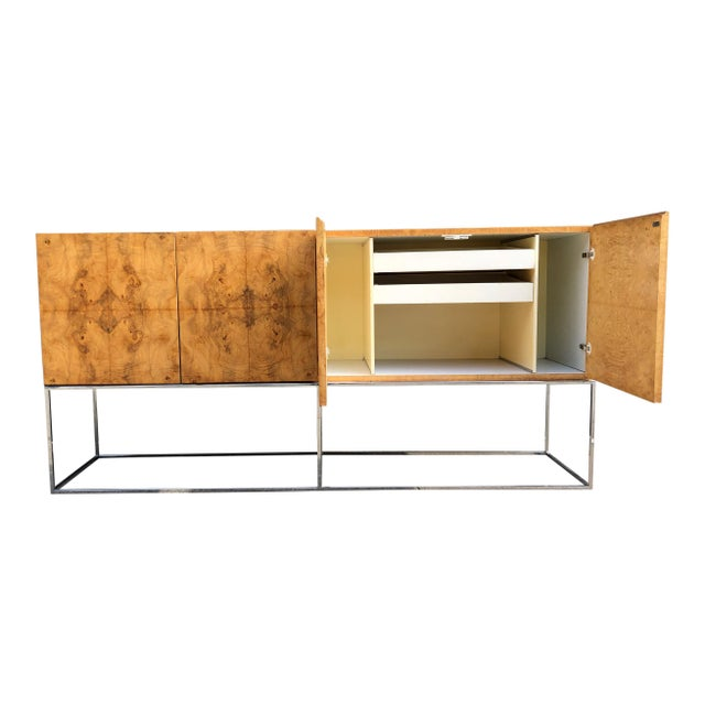 Beautiful Milo Baughman for Thayer Coggin sideboard in bookmatched Olive Burlwood veneer on a slim chrome base. The piece...