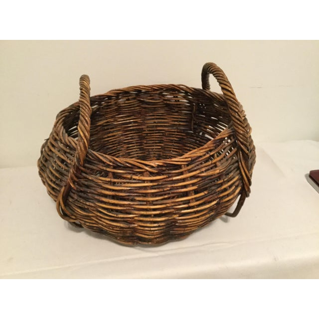 "Decorative very large wooden basketc. , 12"" tall'', 17"" wide, 11"" deep."