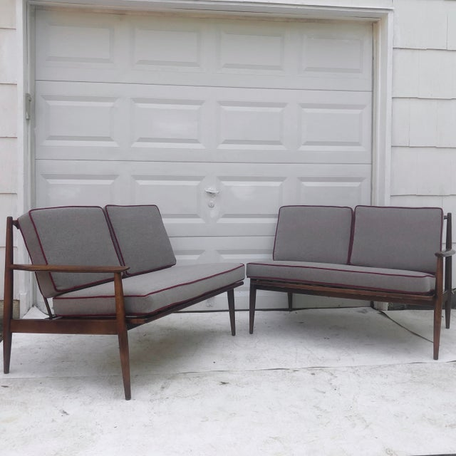 This stylish mid-century sofa from Baumritter features vintage walnut finish with new cushions covered in Knoll textile...