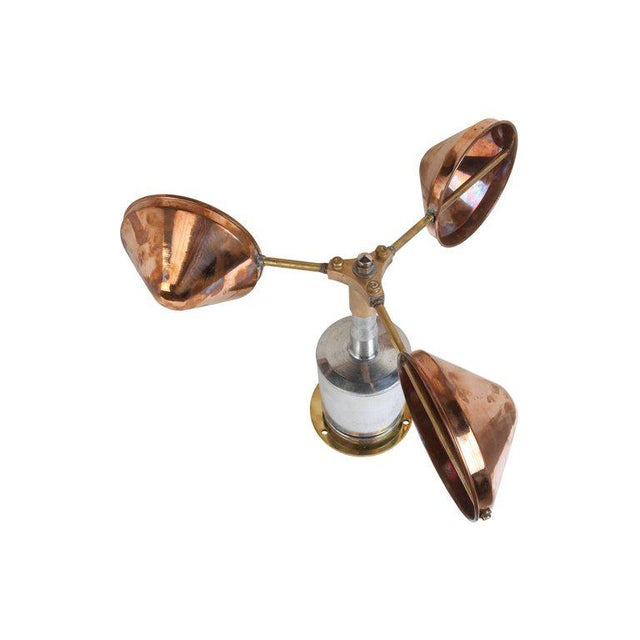 A functional ship's anemometer, used in measuring wind speed. Made of copper, brass and chrome. Can be used outside or in...