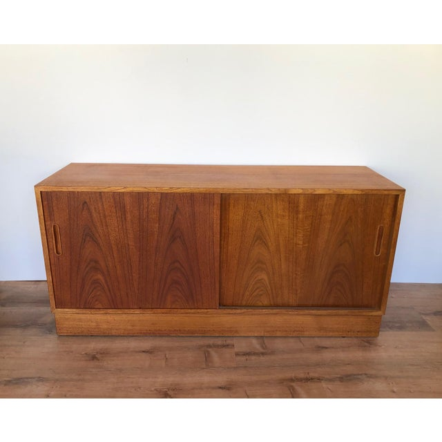 Fully-restored Danish MCM credenza with sliding doors, adjustable shelving, and drawer. Teak. If you are in the Seattle...