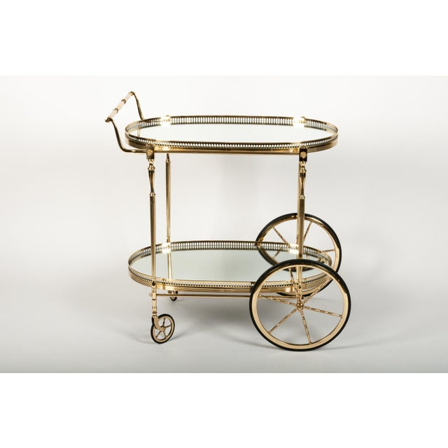 French vintage solid brass wheeled bar cart with mirrored interior shelves and beautifully detailed elements with pierced...