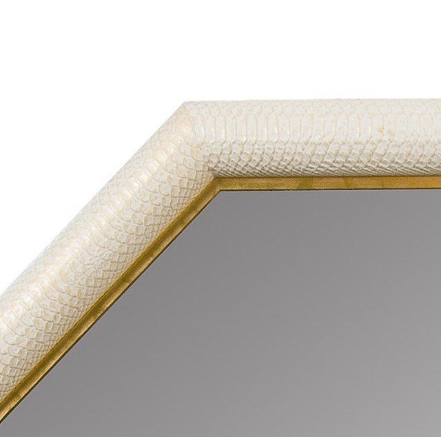 Octagonal Shaped Mirror by KLASP home Italian python embossed leather with hand-painted gold tipping in ivory Inner frame...