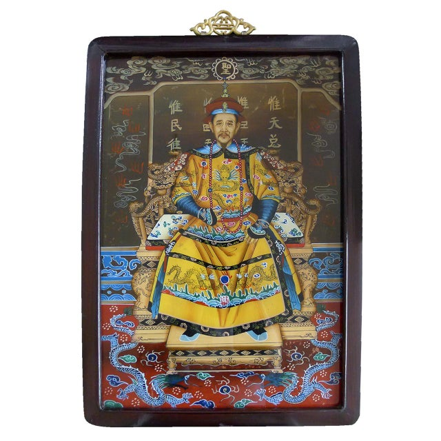 A pair of framed traditional reverse Chinese glass paintings of the Emperor & Empress of the Qing dynasty. The Kangxi...