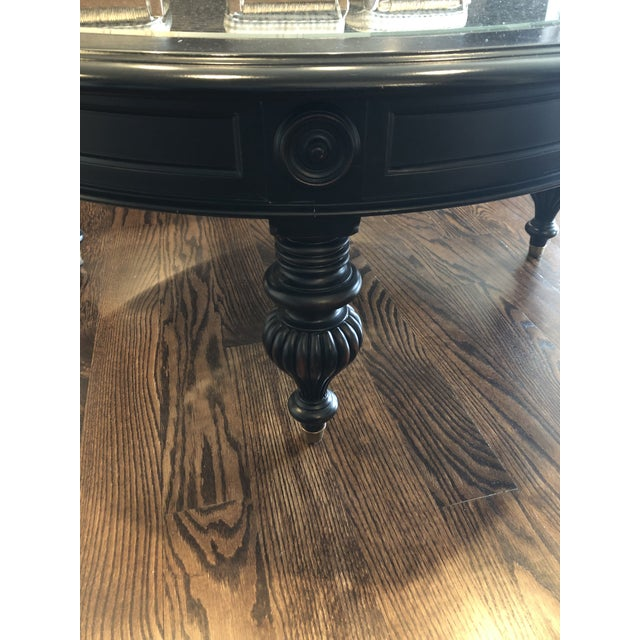 In excellent condition. Black Maya coffee table from Ethan Allen.