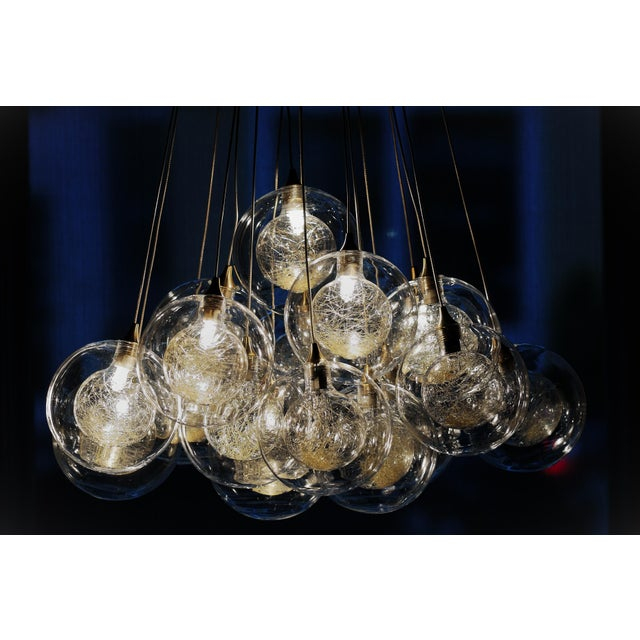 Artisan-Blown glass from Israel, pendants of clear glass filled with gold drizzled floss. A bronze canopy is fitted for...