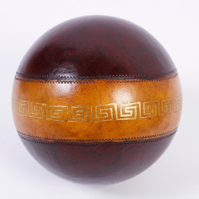 Intriguing set of six decorative bocce or lawn balls with a variety of colors and patterns, featuring embossed gold leaf...